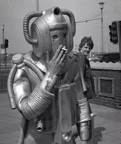 A cyberman from the TV series Doctor Who, in the 1960s. Definitely artificial, but if it were truly intelligent, it would know smoking is bad for you. Via Vintage Geek Culture