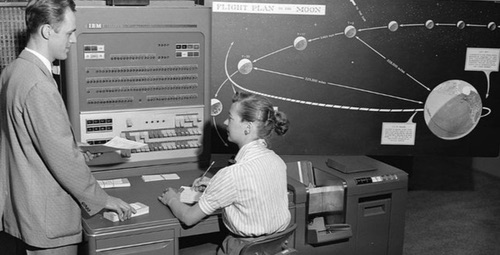 A human computer (right) works on an IBM 704 machine computer at NASA Jet Propulsion Laboratory.  Photo source: NASA