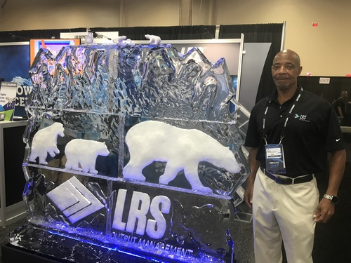 LRS Output Management had an actual ice sculpture at its booth. LRS's Lee Martin (in photo) told me they had one sculpture for each day of the conference, made by a local Las Vegas company.