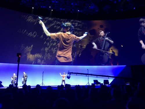 Prior to the first day's keynote, an entertainer warms up the crowd creating art in virtual reality in real time, accompanied by jazzy music.