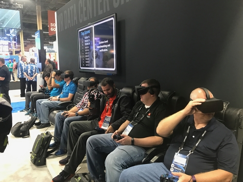 Recruits get indoctrinated for a digital mind-control cult. Either that or VMworld attendees get a virtual reality VSAN demo at the Intel booth.