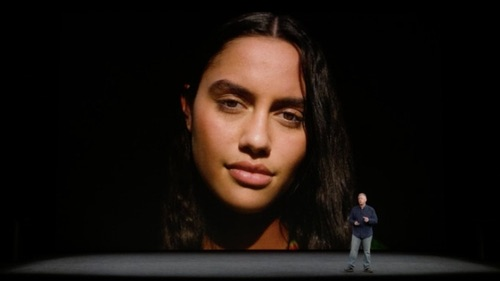 Phil Schiller, Apple senior vice president of worldwide marketing (the tiny man on the right), shows off the new portrait lighting feature on the iPhone 8.