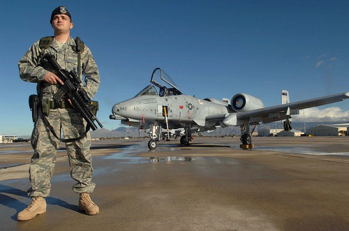 United States Air Force 355th Security Force Squadron guardsman, Senior Airman Mario Fajardo, stands guard  at Davis-Monthan Air Force Base.