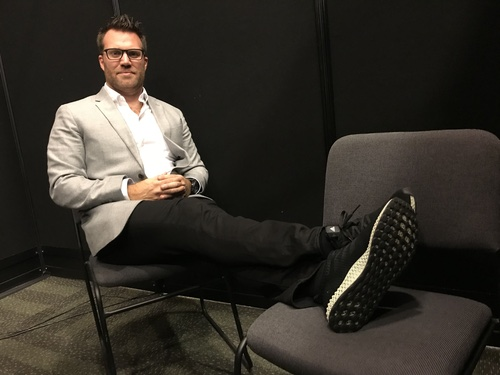 Chris Hutton, Carbon director of operations, looks dapper in Adidas shoes made with his company's 3D printing technology.