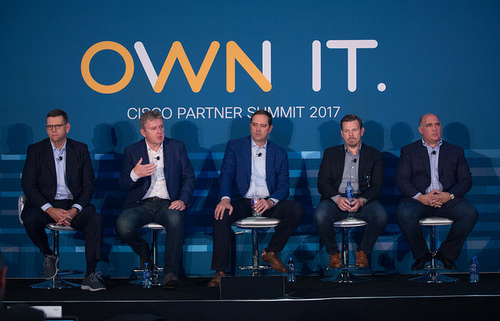 Cisco CEO Chuck Robbins (center), and top Cisco executives field questions from journalists at the recent Cisco Partner Summit. From left, they are David Goeckeler, executive vice president and general manager, networking and security; Chris Dedicoat, executive vice president of sales; Robbins; Rowan Trollope, senior vice president and general manager, applications, including IoT, collaboration and analytics; and Joe Cozzolino, executive vice president of services. Photo by Cisco.