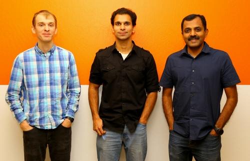 YugaByte founders Mikhail Bautin, Karthik Ranganathan and Kannan Muthukkaruppan, looking nonchalant with their hands in their pockets.