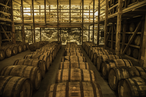 Barrels of whiskey in a storage room, Kentucky.  (Photo from Good Free Photos.)