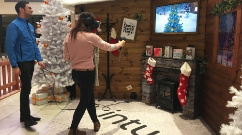 A customer using the HTC Vive headset to decorare a Christmas tree, at intu Victoria Centre in Nottingham.