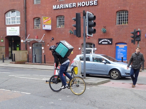 Deliveroo riders can be seen in many cites and towns around the UK, as well around the world. Image: Geograph