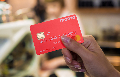 Appetite for challenger banks such as Monzo, with its 'hot coral' color cards, is waning in the UK. (Image: Monzo)