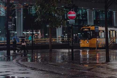 Manchester is famous for its yellow public transport tram network. (Image: Mat Atherton, Unsplash)