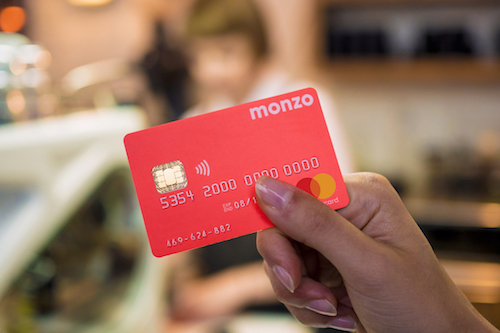 Monzo's hot coral cards are a recognizable sight in London. (Image: Monzo)