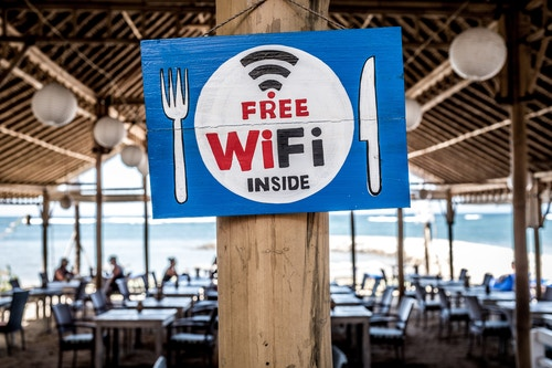 Many coffee shops, supermarkets, and buses or trains now have freely available public WiFi. (Image: Bernard Hermant, Unsplash)