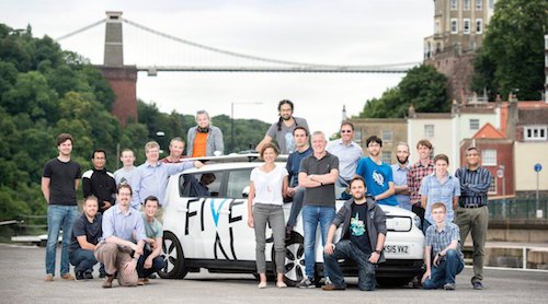 The FiveAI team, complete with car. CEO and co-founder Stan Boland is in the middle in dark polo shirt and jeans. Image: FiveAI