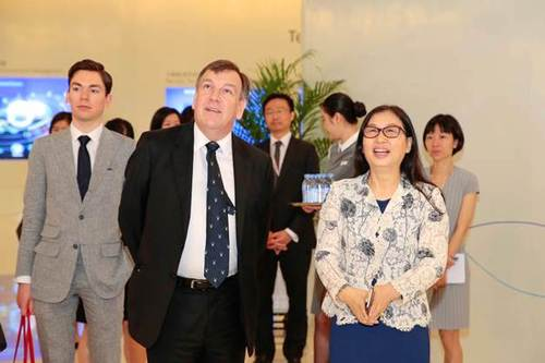 UK Secretary of State for Culture, Media and Sport John Whittingdale, middle, and Huawei Chairwoman Sun Yafang tour the Huawei Exhibition Hall on Friday.