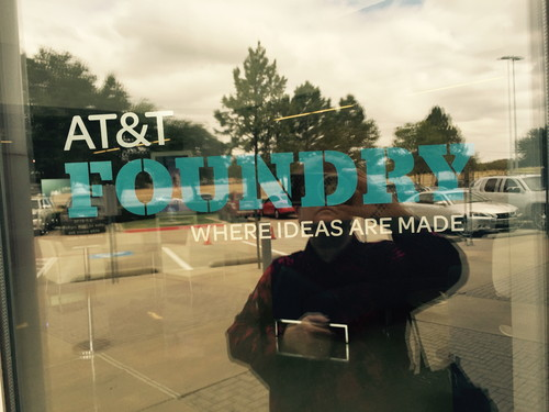 In case you wondered if I was really there, here's the proof: An accidental selfie of me (and the parking lot) at the front door of AT&T's Foundry in Plano, Texas, on an uncharacteristically cloudy day. This facility was opened in 2011, initially to focus on business solutions.