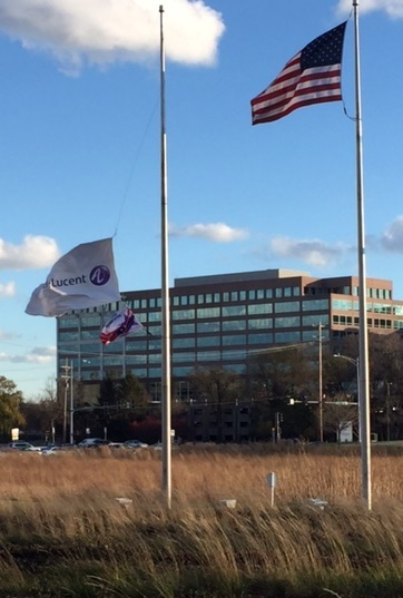 It was a very windy day in Chicagoland on the day of my field trip. Outside the Alcatel-Lucent complex in Naperville, Ill., the flags were very busy.