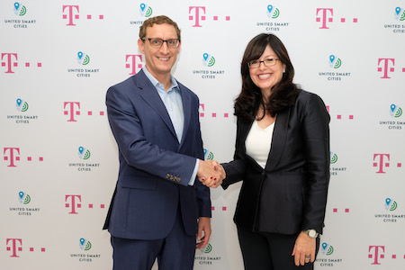 Markus Keller, who heads smart cities at DT, and Kari Aina Eik, USC executive director, announced the two organizations' partnership with a traditional handshake and discussions about some leading edge technologies such as IoT devices, analytics, large databases and high-speed networks.