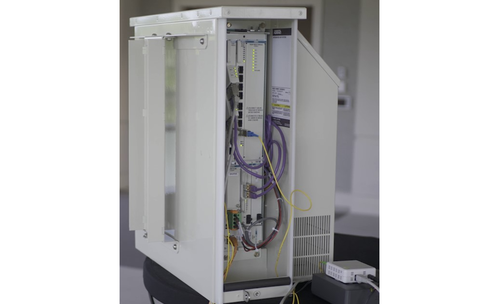 ADTRAN says its new micro-cabinet, at about 35 pounds, is light enough to be deployed on poles and walls.   (Image source: ADTRAN)